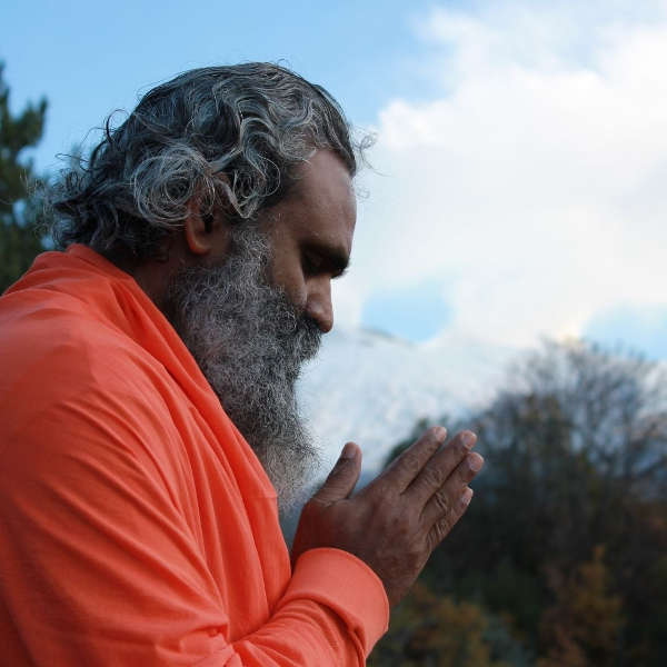 heros journey mentor archetype blog article picture with man praying