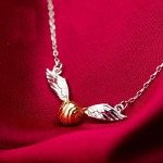 holiday giftguide for readers who love fantasy golden snitch necklace