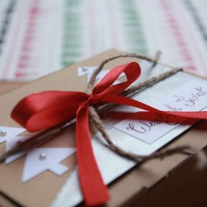 box with a red ribbon tied around it