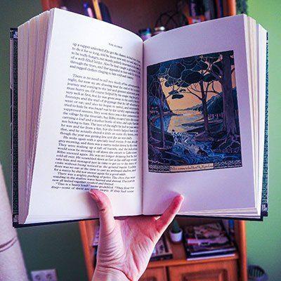 about Iris Marsh open hobbit book with illustration